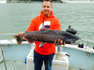 Client holding salmon catch